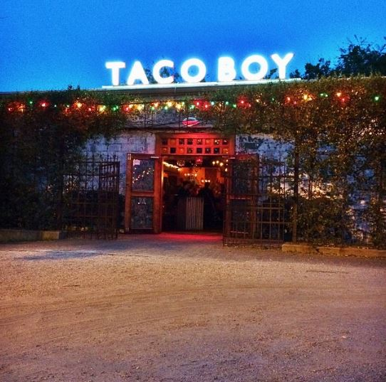 Like moths to a flame we flock to the glow of the Taco Boy sign.